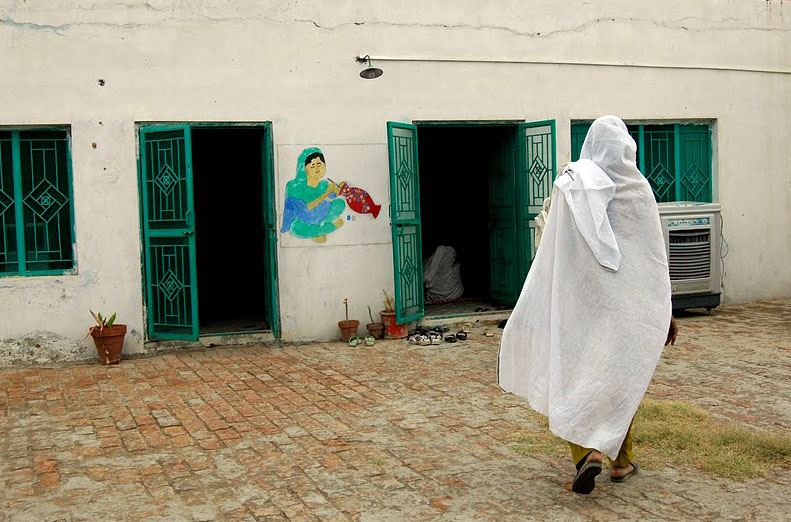 A woman enters the Potohar Organization for Development Advocacy artisan center in Chakwal, Pakistan